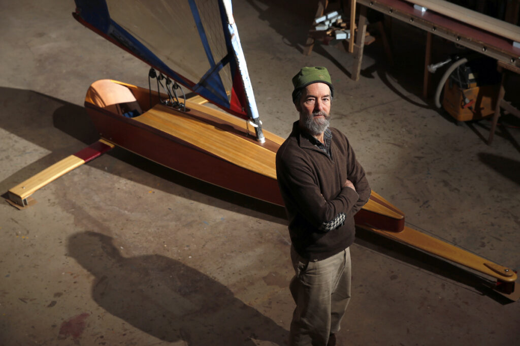 Bill Buchholz builds ice boats in his cavernous, still-unfinished boat shop in his Camden woods shop. These days he focuses more on custom-made ice boats, like the mini skeeter that was developed four years ago.