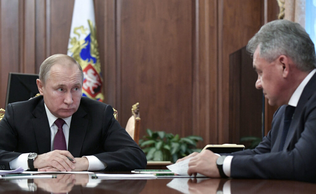Russian President Vladimir Putin, left, speaks to Defense Minister Sergei Shoigu in Moscow on Saturday. The collapse of the nuclear arms treaty has raised fears about a Cold War repeat. AP