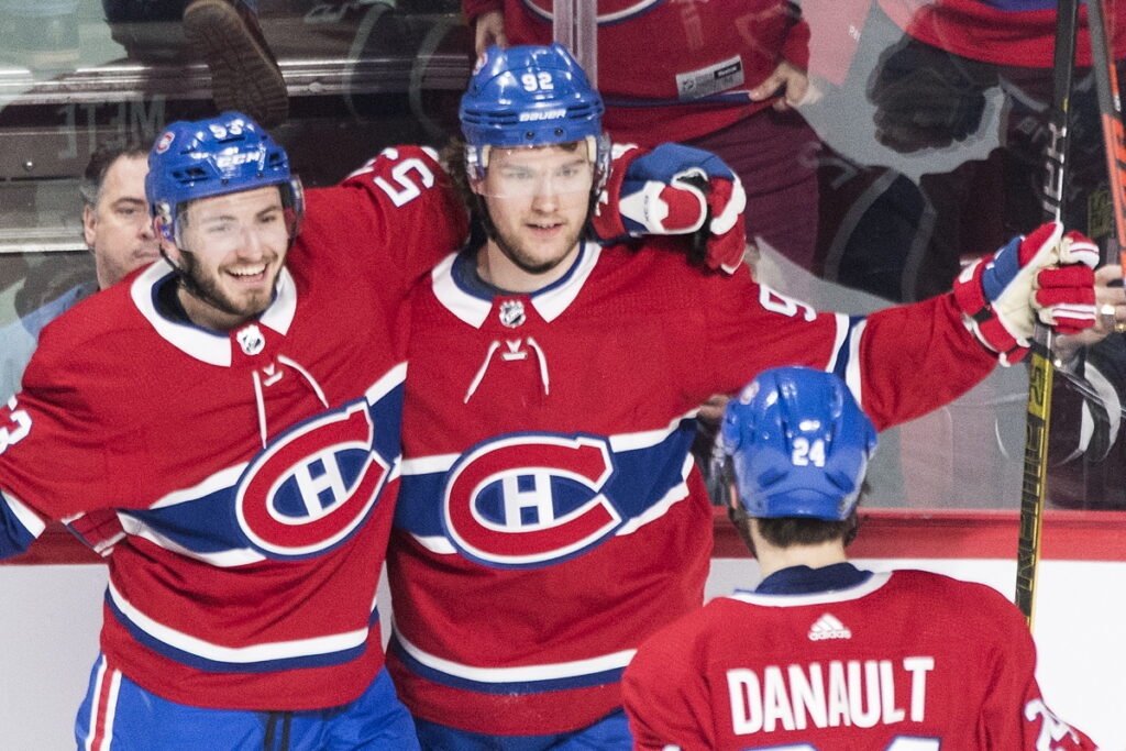Montreal Canadiens' Jonathan Drouin, center, celebrates with teammates Victor Mete, left, and Phillip Danault after scoring the winning goal in overtime as the Canadiens beat the Edmonton Oilers 4-3 win Sunday in Montreal.
