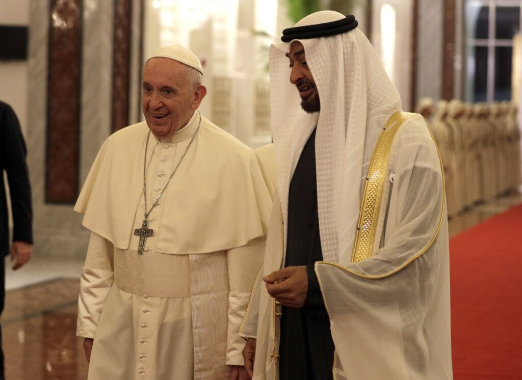 Pope Francis is welcomed by Abu Dhabi's Crown Prince Sheikh Mohammed bin Zayed Al Nahyan at the Abu Dhabi airport in United Arab Emirates on Sunday.