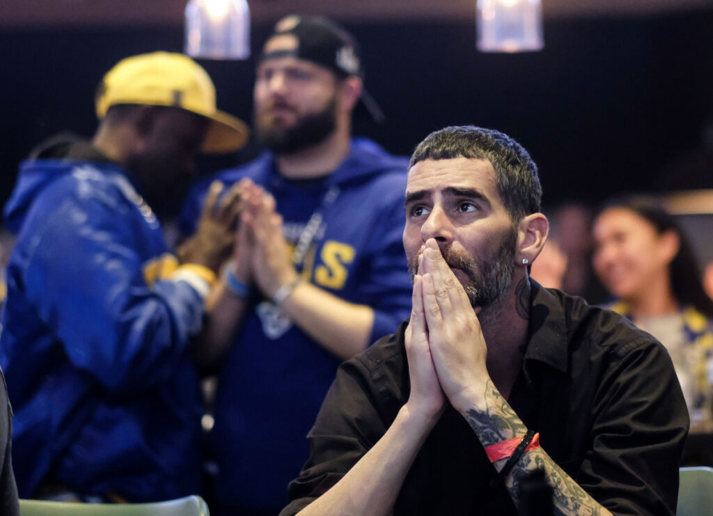 Rams fan Jason Skelton reacts during a viewing party near the end of Super Bowl 53