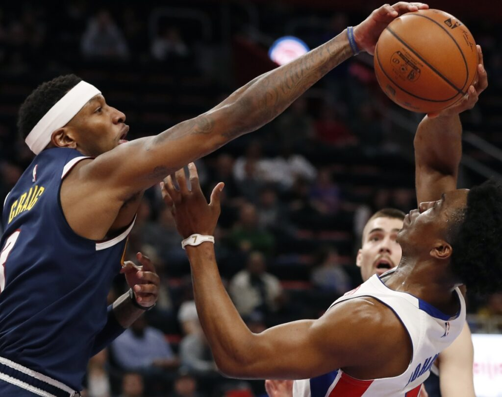 Torrey Craig of the Denver Nuggets blocks a shot by Stanley Johnson of the Detroit Pistons during the first half of Detroit's 129-103 victory Monday night that snapped Denver's six-game winning streak.