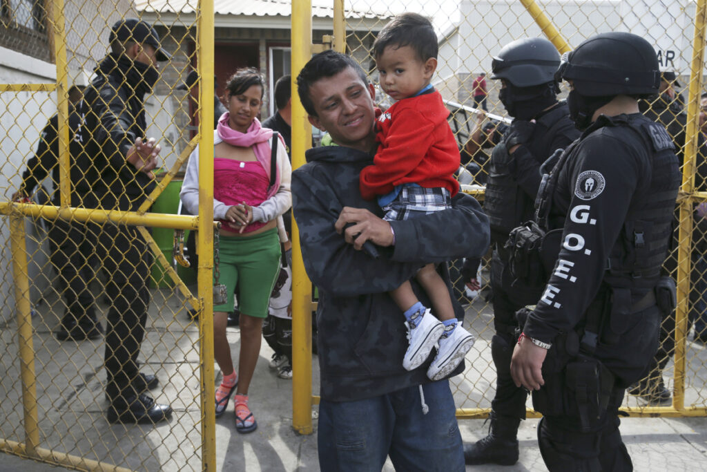 A Central American family that is part of a migrant caravan leaves a shelter Tuesday in Piedras Negras, Mexico, across the border from Eagle Pass, Texas.