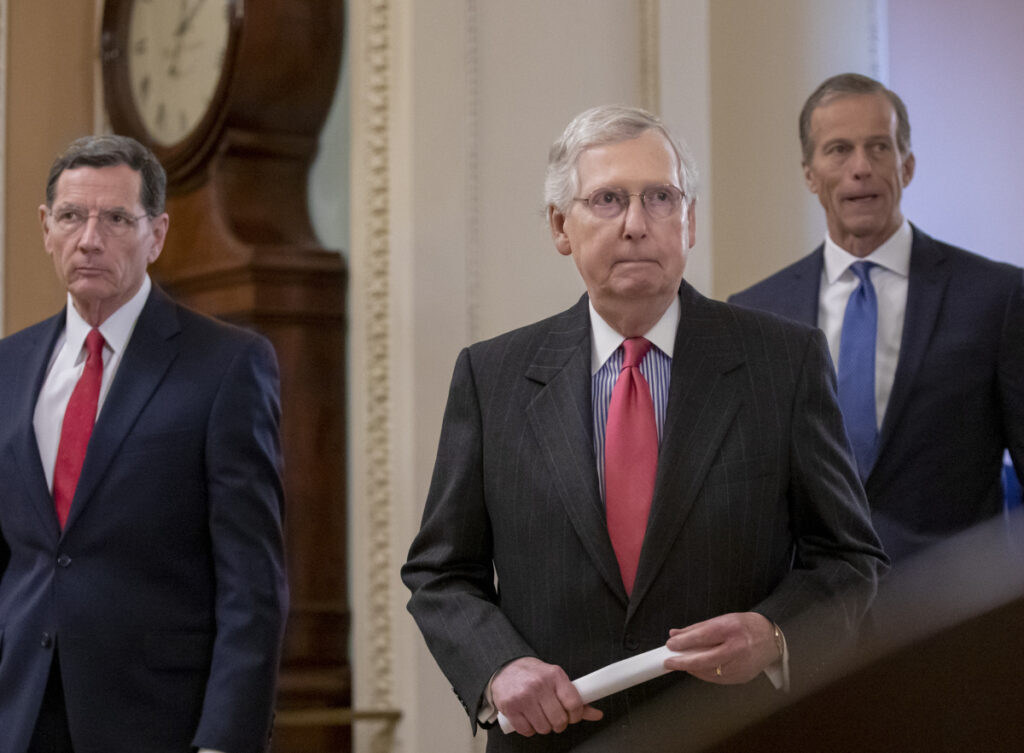 Associated Press/J. Scott Applewhite Senate Majority Leader Mitch McConnell, R-Ky., flanked by Sens. John Barrasso, R-Wyo., left, and John Thune, R-S.D., meets with reporters Tuesday.