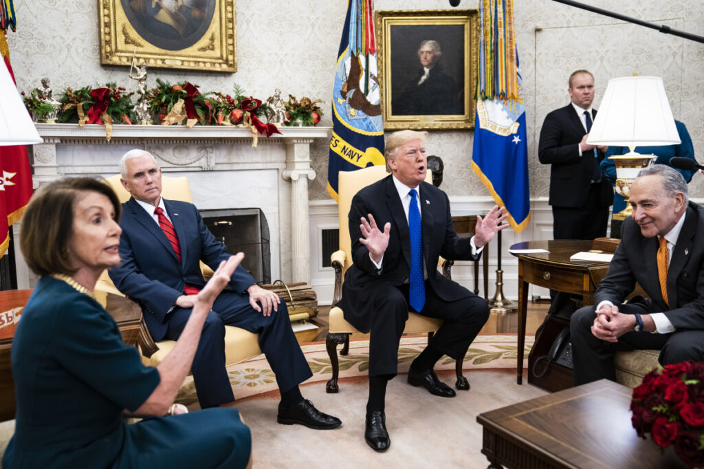 President Trump debates with House Minority Leader Nancy Pelosi, D-Calif., left, and Senate Minority Leader Chuck Schumer, D-N.Y., right, as Vice President Mike Pence listens during a meeting in the Oval Office in December. MUST CREDIT: Washington Post photo by Jabin Botsford.