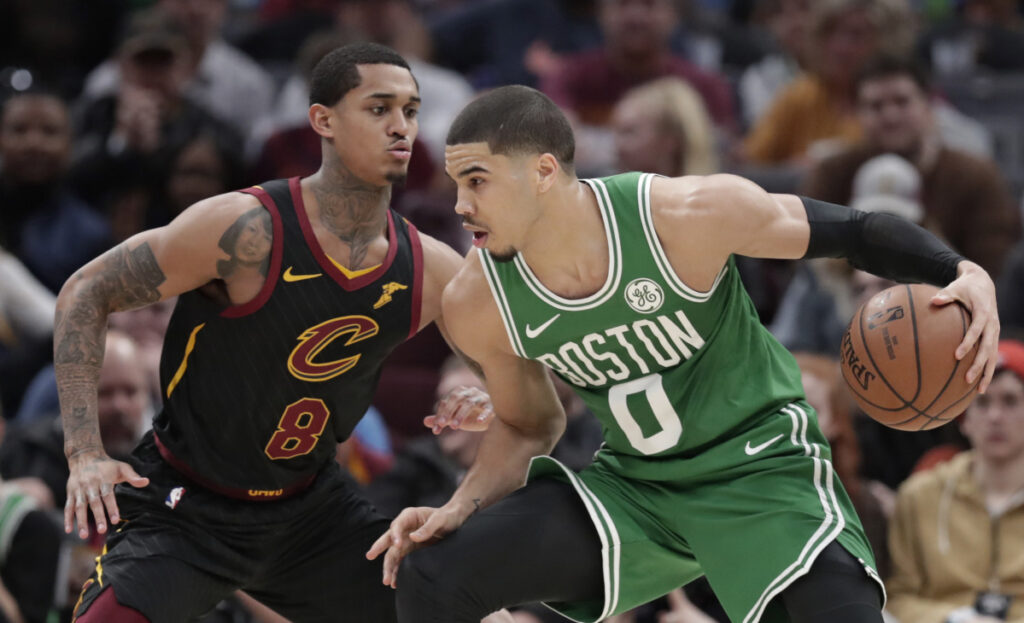 Boston's Jayson Tatum drives past Cleveland's Jordan Clarkson during the Celtics' 103-96 win Tuesday in Cleveland. Tatum finished with 25 points.