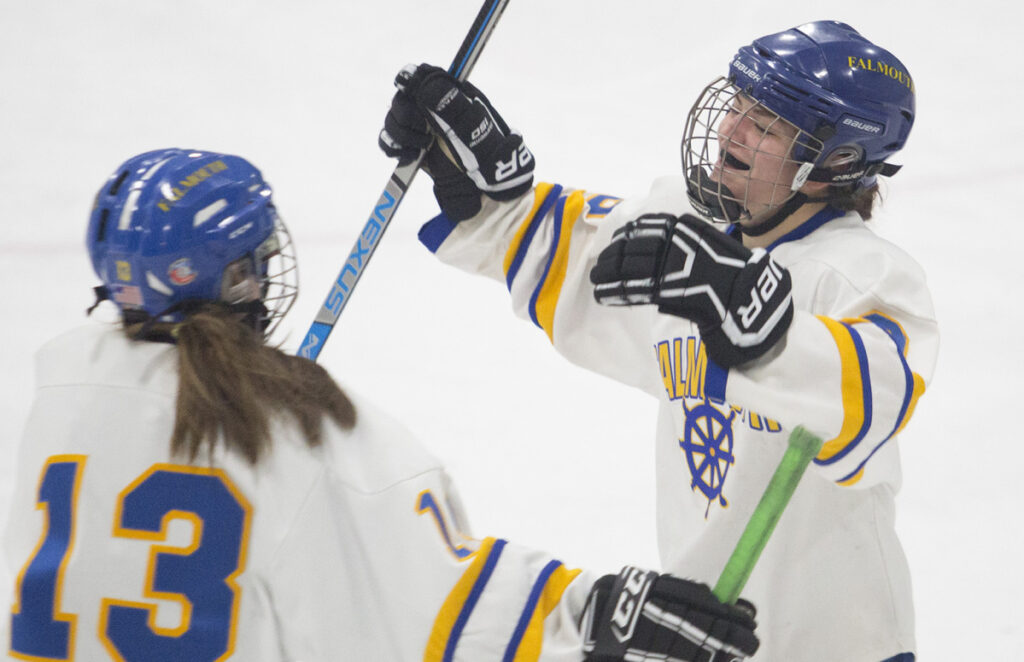 Kayla Sarazin, right, celebrates her fourth goal of the game along with Viviana Griffin as Falmouth puts the finishing touches on a 7-1 win over Portland/Deering in the first round of the girls' hockey playoffs Wednesday.
