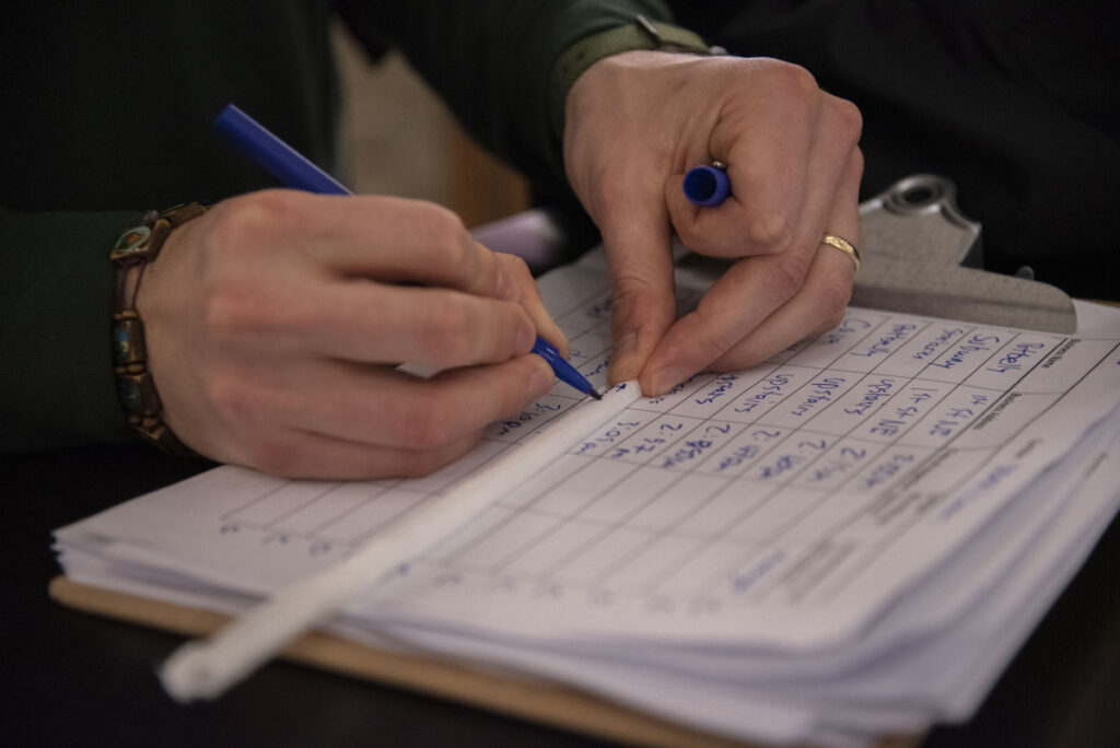 Zach Rybarczyk, who works for Washington, D.C.'s Department of Energy and Environment, jots the name of a Union Station restaurant on the paper sleeve of a plastic straw.