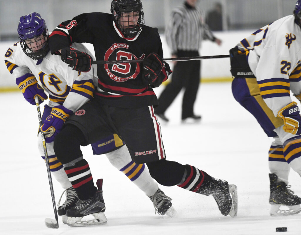Scarborough's Nolan Matthews tries to fend off Kevin Connolly of Cheverus in Thursday's game at Portland. Matthews scored three goals as the Red Storm ended a four-game losing streak with a 5-0 win to even their record at 6-6-1.