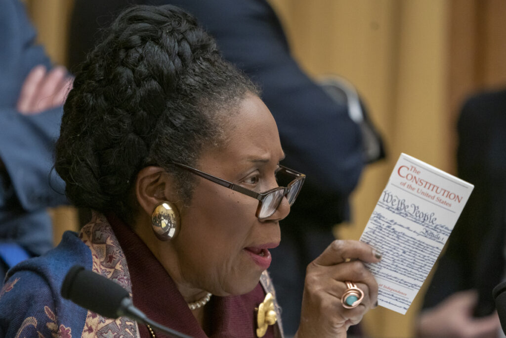 House Judiciary Committee member Rep. Sheila Jackson Lee, D-Texas, holds a pocket-size copy of The Constitution as she questions Acting Attorney General Matthew Whitaker on Capitol Hill on Friday in Washington.
