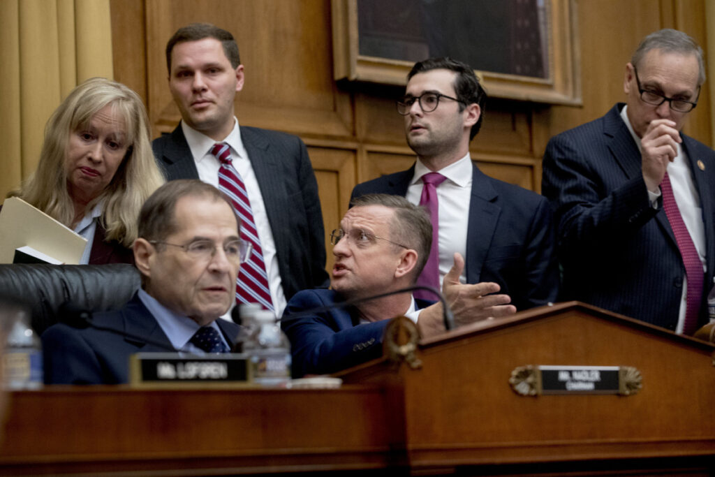 Rep. Doug Collins, R-Georgia, the top Republican on the House Judiciary Committee, center, objects to Judiciary Committee Chairman Jerrold Nadler, D-N.Y., left, summoning Acting Attorney General Matthew Whitaker before the Democratic-controlled panel on Capitol Hill on Friday in Washington.