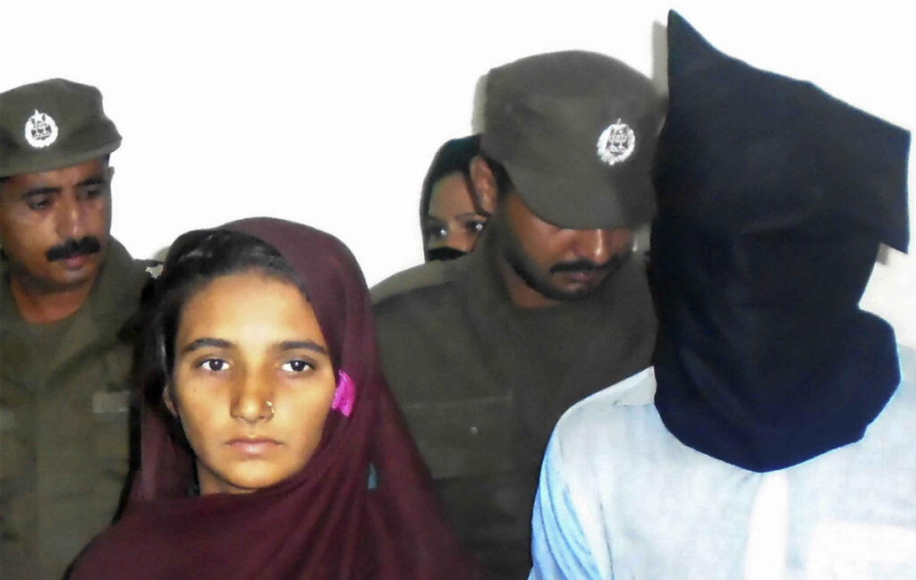 Asia Bibi, left, and her boyfriend, Shahid Lashari, appear at a police station in Pakistan in 2017. Bibi, a Christian, was acquitted of blasphemy but remains threatened by extremists. Associated Press/Iram Asim