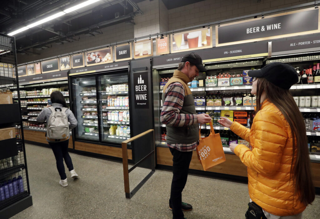 Online giant Amazon has propelled cashier-less technology at its Amazon Go stores, like this one in Seattle. Other merchants are exploring similar methods to allow shoppers to buy without waiting in line.