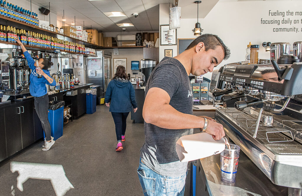 Tulio DeAlmeida makes an iced macchiato at Aroma Joe's in Auburn. There are 63 locations in six states.