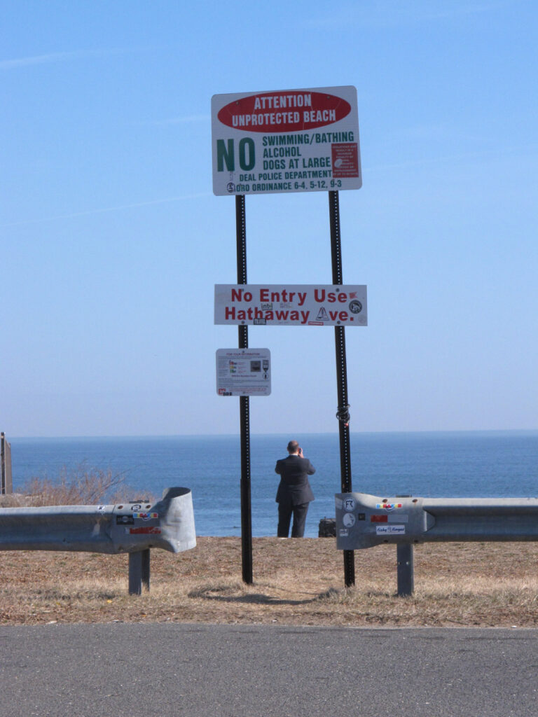 Andrew Provence, an attorney for the American Littoral Society, looks out at the ocean at the end of a street in Deal, N.J., that the town plans to give up to a private property owner. Beach access advocates fear a popular spot for surfers, fishermen and others to get onto the sand will be blocked off, but the town insists that won't be the case, and the American Littoral Society is suing Deal to try to prevent the transaction.