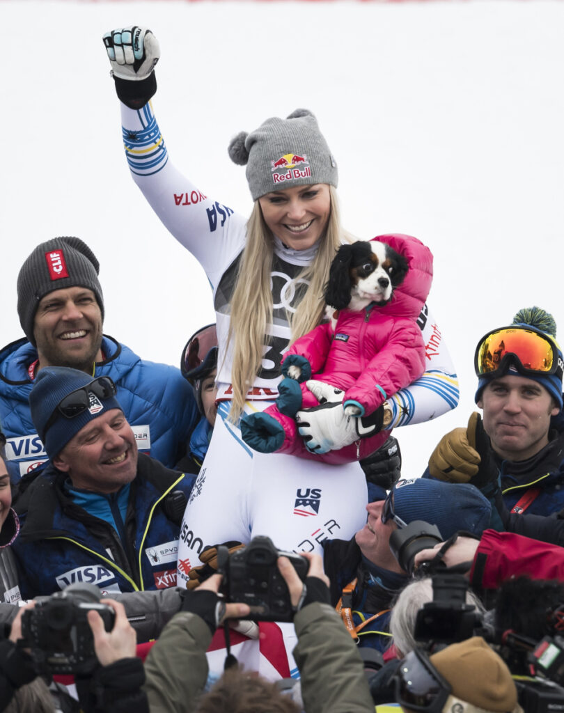Lindsey Vonn celebrates with her dog, Lucy, after finishing with a bronze medal in the women's World Cup downhill Sunday at Are, Sweden. This was the final race of Vonn's incredible career.