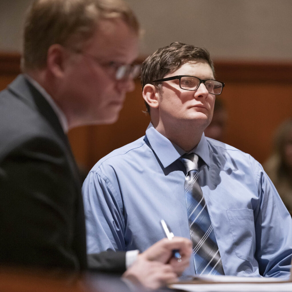 Noah Gaston, right, and his attorney, James Mason, listen during a hearing in Portland on Jan. 22. Gaston admits he shot and killed his wife at their home, but claims he mistook her for an intruder.