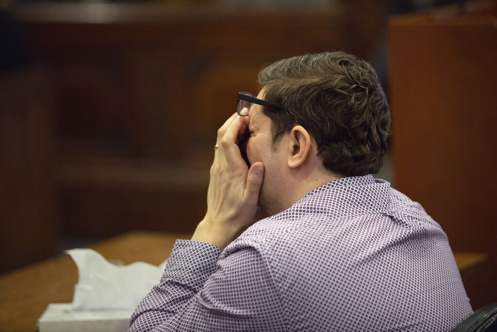 Noah Gaston reacts to hearing the call he made to 911 after he shot his wife on Jan. 14, 2016.