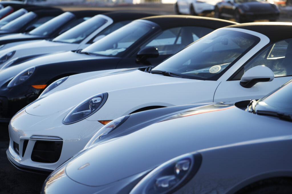 A long row of unsold 2019 911 Carrera GTS cabriolets sits at a Porsche dealership in Littleton, Colo. Borrowers are behind in their auto loan payments in numbers not seen since delinquencies peaked at the end of 2010, according to the Federal Reserve Bank of New York.