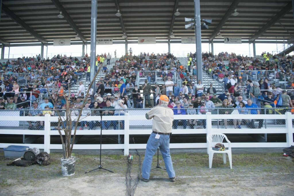 Robert Lambert welcomes the crowd on June 9 to the moose call demonstration at the Skowhegan Moose Fest at the Skowhegan Fairgrounds. A Guinness World Record was set by the 1,054 people who simultaneously made moose calls.