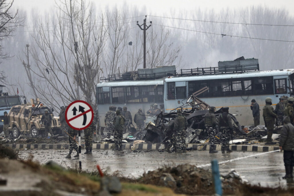 Indian paramilitary soldiers stand by the wreckage of a bus after an explosion in Pampore, Indian-controlled Kashmir on Thursday.