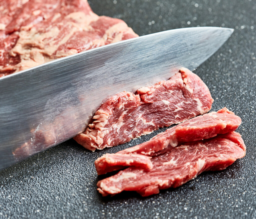 Freezing meat for a brief time makes cutting easier.