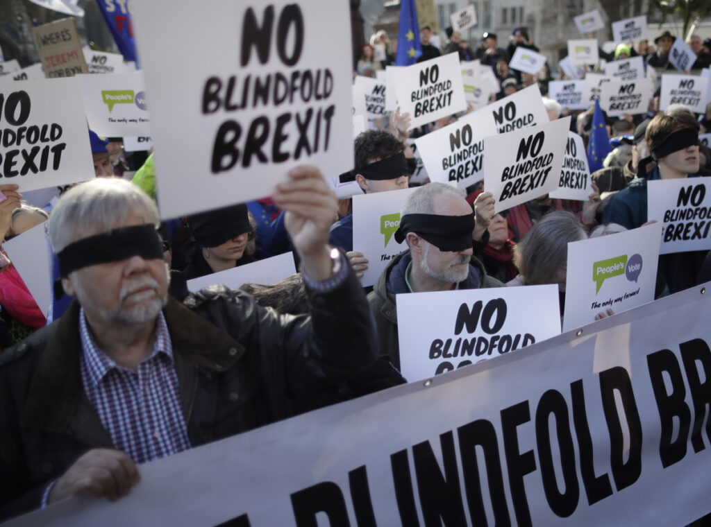 Remain in the European Union supporters wear blindfolds as they take part in a protest calling for a second referendum on Britain's EU membership.