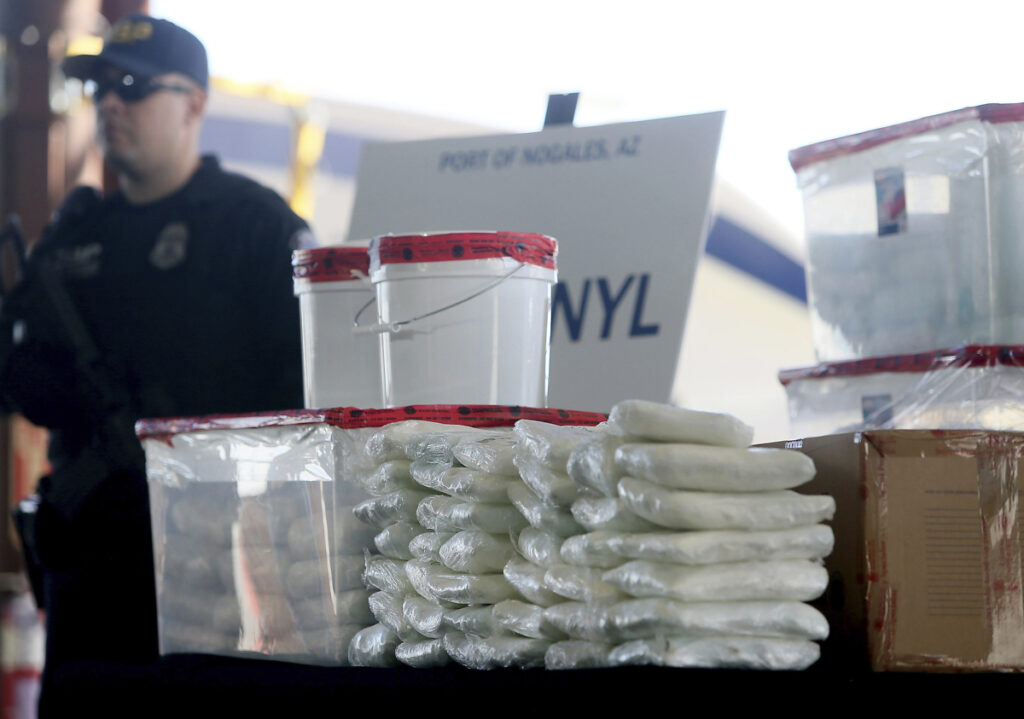 A display of fentanyl and meth that was seized by Customs and Border Protection officers over one weekend at the Nogales Port of Entry in Nogales, Ariz., is shown at a Jan. 31 news conference.