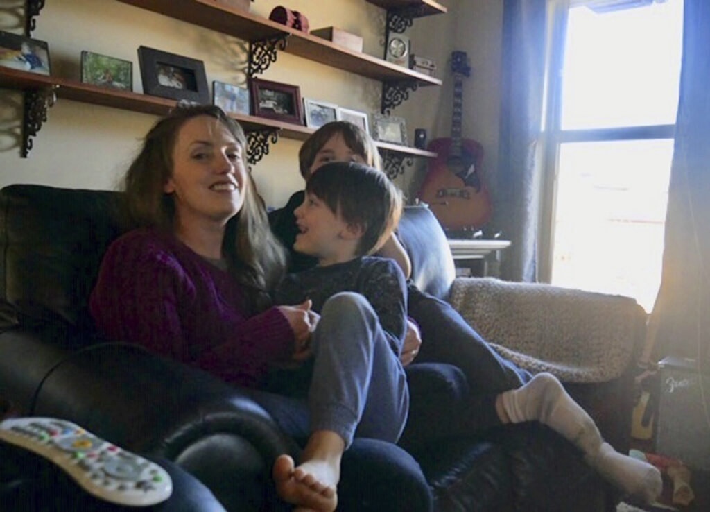 Aimee Maddonna sits with her children at her home in Simpsonville, S.C. The South Carolina mother has sued both the state and federal government, saying she's a victim of religious discrimination on the part of a federally funded foster-care agency that turned her down because of her Catholic faith.