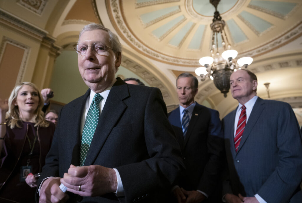 Senate Majority Leader Mitch McConnell, R-Ky., joined by fellow Republicans, speaks to reporters about the bipartisan compromise worked out to avert another government shutdown. The bill included funds for border security.