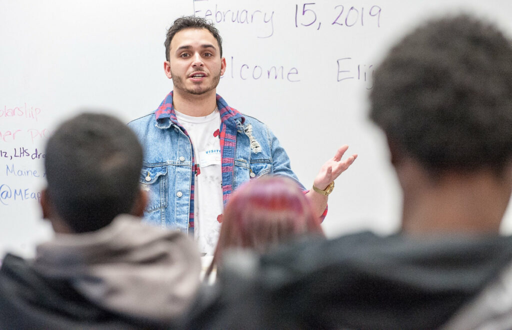 """Former Lewiston High School student Elijah Solis speaks to a group of students during Friday's Jobs for Maine's Graduates class at Lewiston High School. Solis, 23, made his TV debut two weeks ago on """"Magnum P.I."""""""