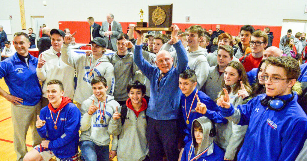 The Mt. Ararat/Brunswick wrestling team celebrates after winning the Class A wrestling state championship on Saturday at Cony High School in Augusta.