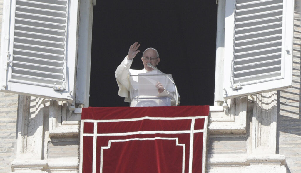 Pope Francis delivers his blessing during the Angelus noon prayer at the Vatican on Sunday. More than 100 top bishops will convene at the Vatican this week to address the issue of clergy sex abuse.