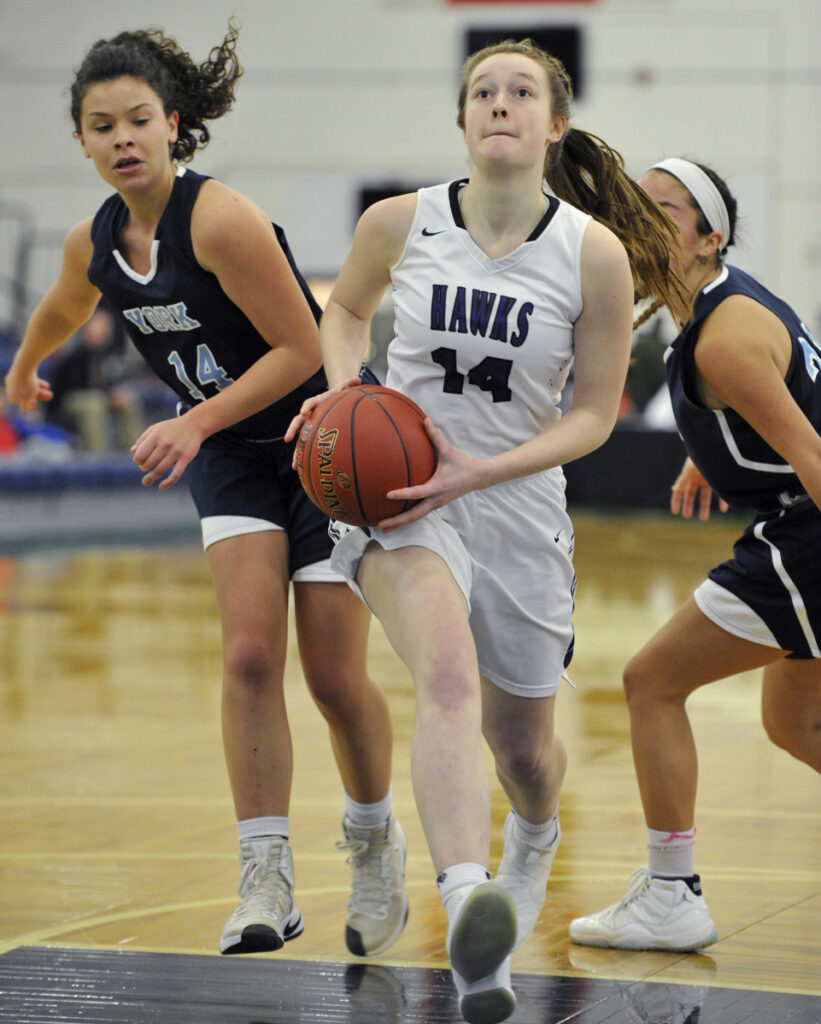 Marshwood guard Kayla Goodwin drives into the lane after eluding York's Hannah Gennaro during the Hawks' 59-37 win in the Class A South quarterfinals on Monday at the Portland Expo.