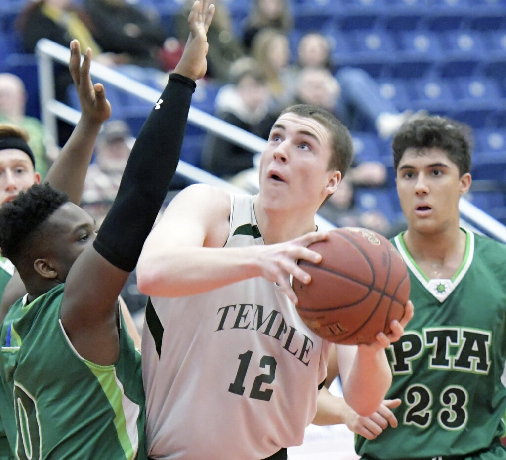 Temple Academy's Nick Blaisdell drives to the basket during a 63-44 win over Pine Tree Academy in a Class D South quarterfinal Monday at the Augusta Civic Center.