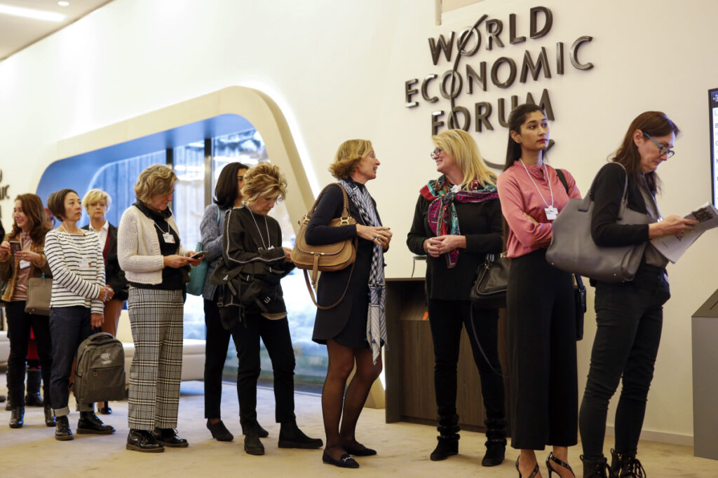 Female attendees line up for a panel session at the World Economic Forum in Davos, Switzerland, on Jan. 23. A new analysis found married women are 991 percent more likely than single women to be in a 1 percent household which earned $845,000 or more in 2016.