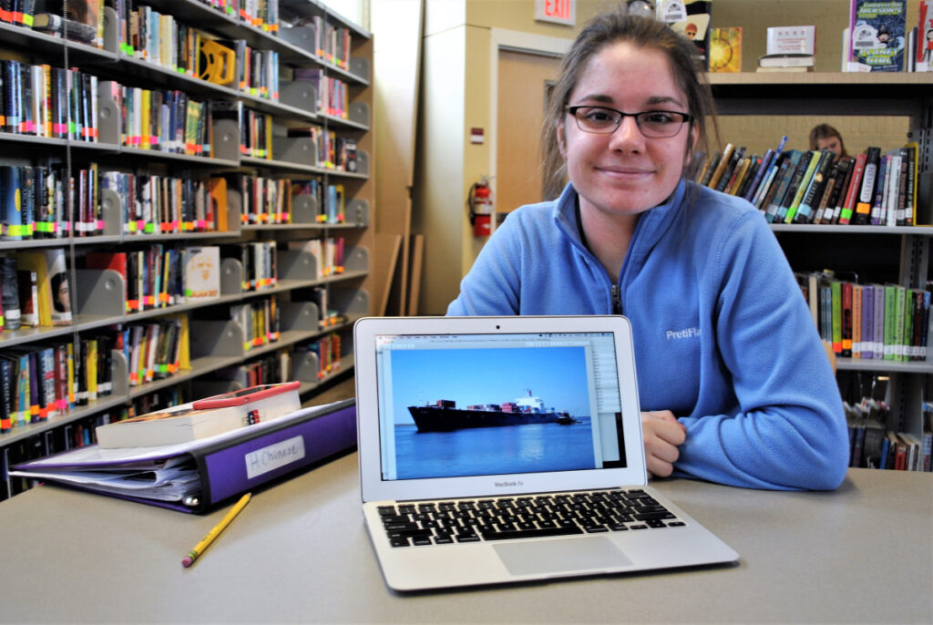 Sophia Meyer sits with her laptop at the Thornton Academy library on Friday.