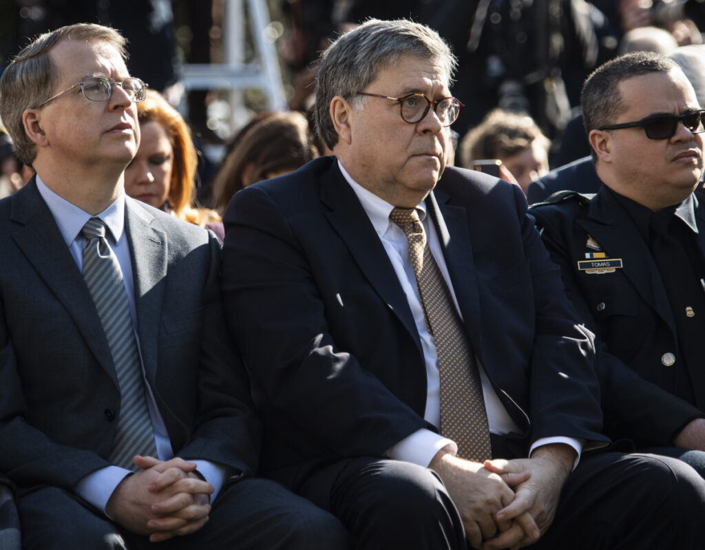 Attorney General William Barr listens to President Trump speak in the Rose Garden at the White House in Washington on Friday.