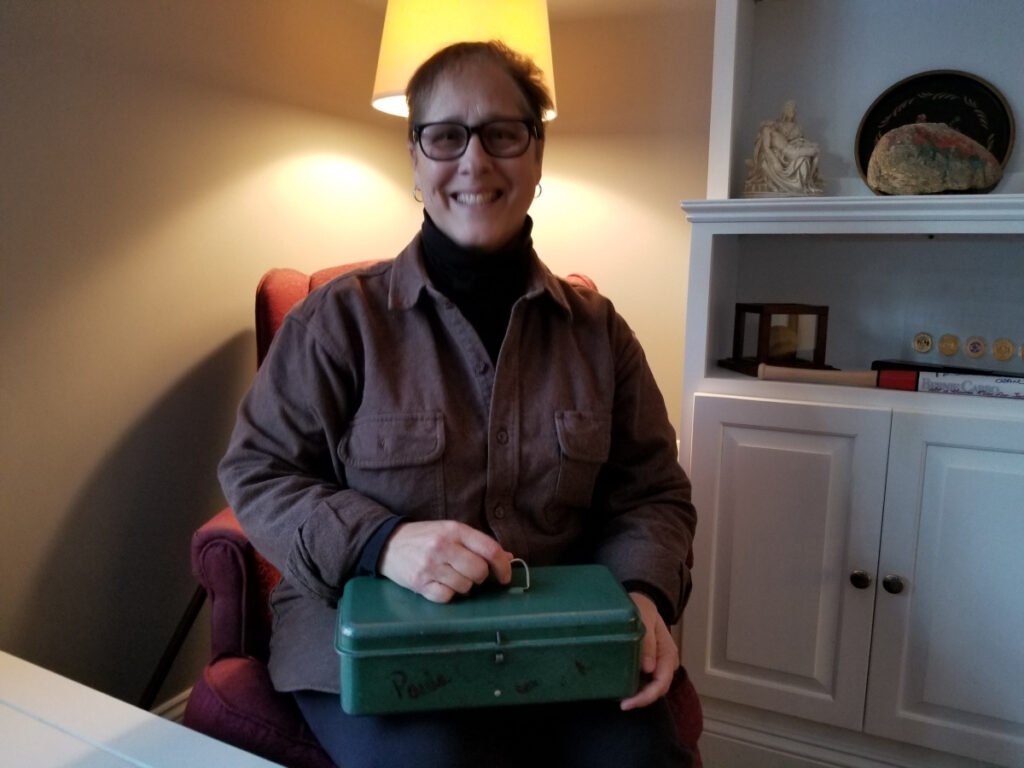 Paula Currie-Raymond with Mémère's green box.