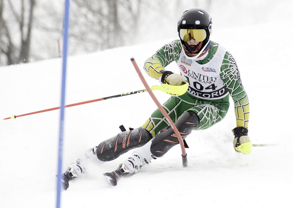 Killian Lathrop of Cape Elizabeth goes around a gate during his second run in the Class B slalom Wednesday at Black Mountain in Rumford. Lathrop won the event for the second straight year.