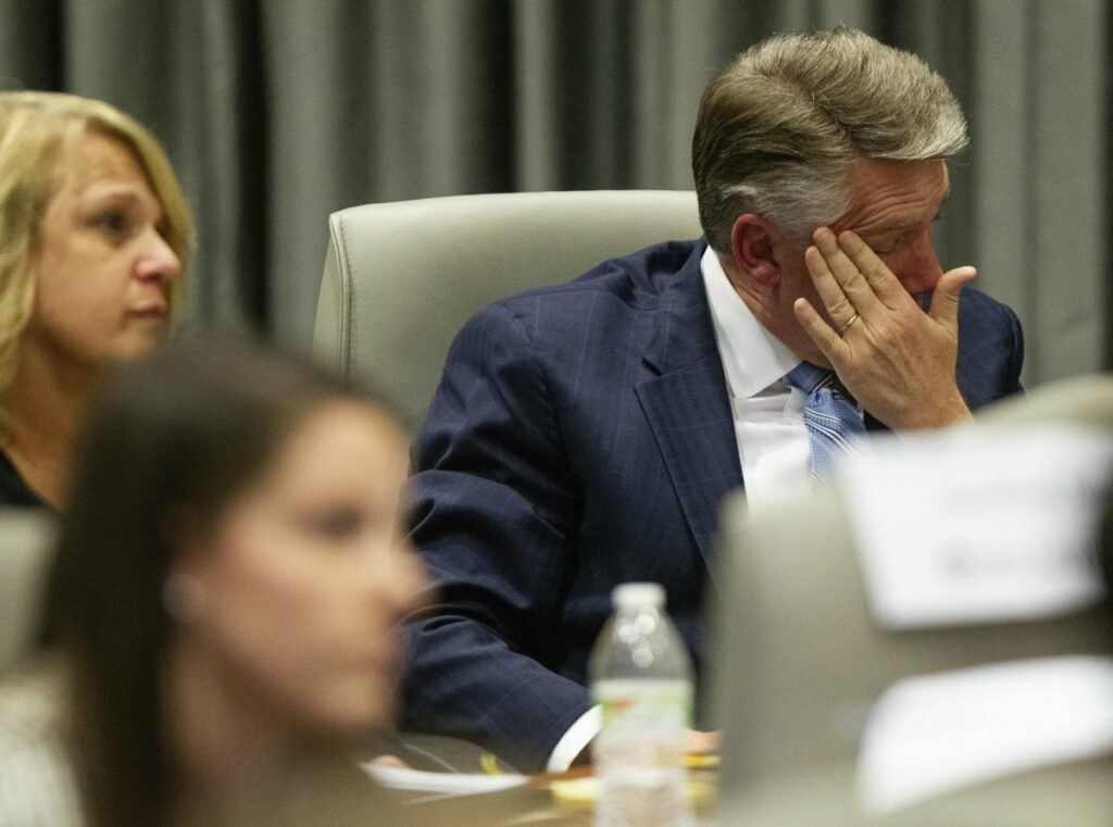 Mark Harris, Republican candidate in North Carolina's 9th Congressional race, fights back tears at the conclusion of his son John Harris's testimony during the third day of a public evidentiary hearing on the 9th Congressional District voting irregularities investigation on Wednesday.