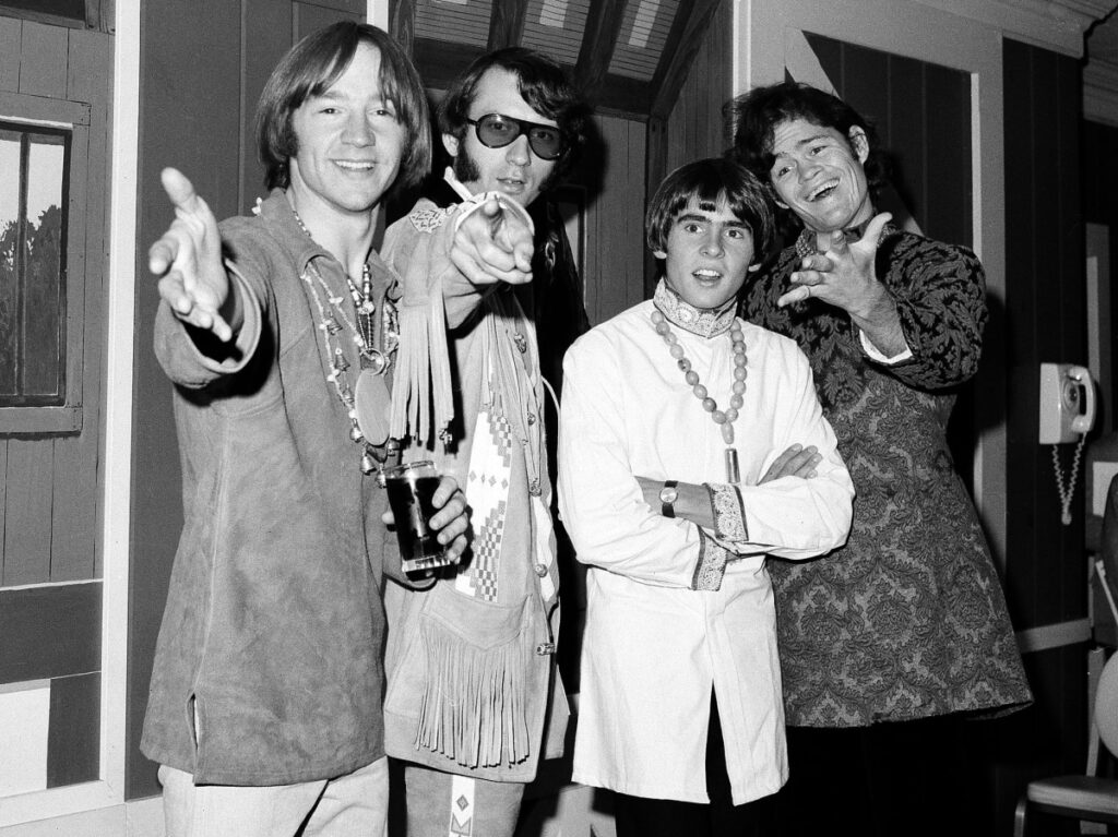 The Monkees – from left, Peter Tork, Mike Nesmith, David Jones and Micky Dolenz – appear at a news conference in New York in 1967. Tork, who played the clueless bass-guitarist in the made-for-television rock band, died Thursday.