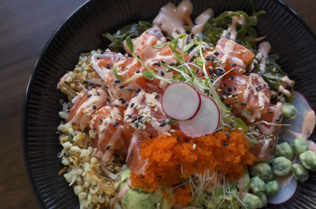 The salmon poké at Crunchy Poké Bar in Portland is topped with a creamy Japanese-mayonnaise sauce and brilliant orange masago (capelin roe).