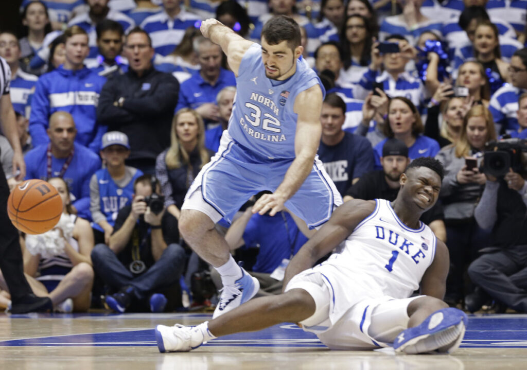 Zion Williamson of Duke falls to the floor Wednesday night after trying to plant his left foot. His sneaker fell apart and Williamson landed in an awkward position. He suffered a mild right knee sprain and isn't expected to be out of the lineup for long.