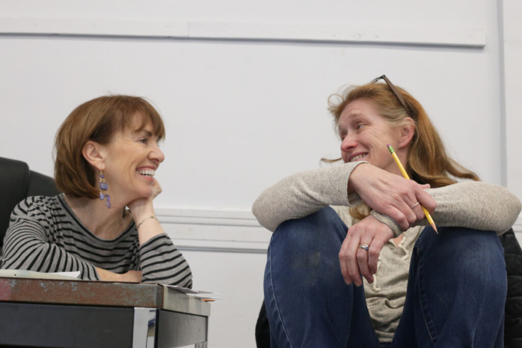 "Playwright Monica Wood, left, and director Sally Wood during a rehearsal for ""The Half-Light,"" opening this week at Portland Stage. The Woods are not related, but ""I think that Sally and I must have been connected in a previous life. We really do think alike, and she's a uniquely insightful director,"" Monica Wood said."
