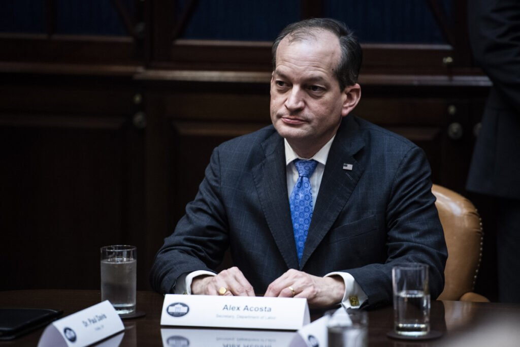 Labor Secretary Alex Acosta listens to President Trump during a meeting about health care at the White House on Jan. 23.