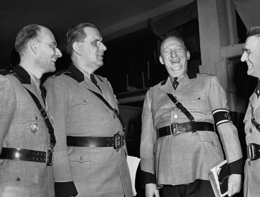 Fritz Kuhn, second from left, national leader of the German-American Bund, joins other uniformed Bundsmen before the rally on Feb. 20, 1939. A short film on the rally is up for an Oscar Sunday.