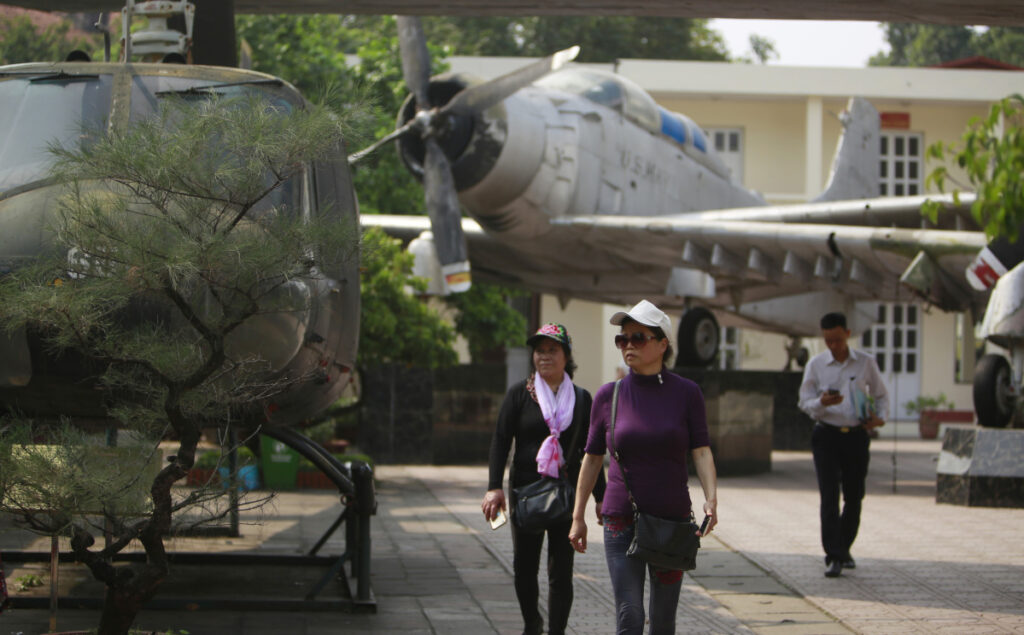 Visitors walk next to American aircraft at the Vietnam Military History Museum in Hanoi, Vietnam, last week. The Vietnamese capital once trembled as waves of American bombers unleashed their payloads, but when Kim Jong Un arrives here for his summit with President Trump he won't find rancor toward a former enemy. Instead, the North Korean leader will get a glimpse at the potential rewards of reconciliation.