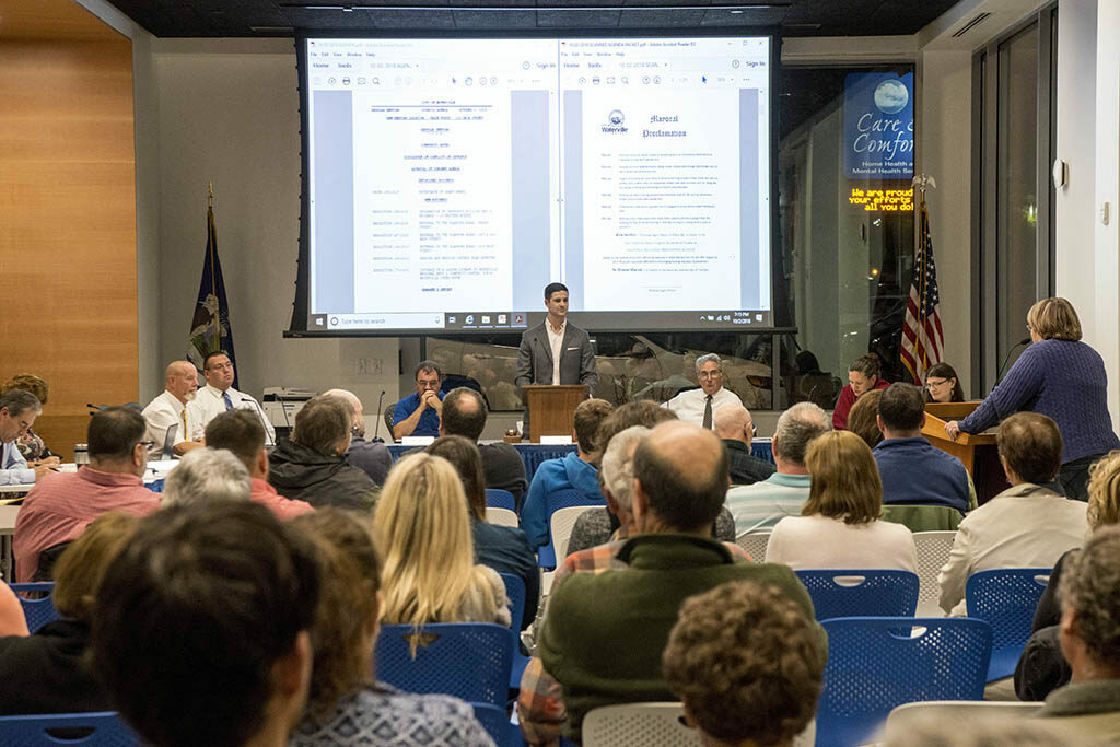 Mayor Nick Isgro presides as the Waterville City Council meets in the Chace Community Forum in the new Colby College dorm downtown on Oct. 2. Some residents want the venue for council meetings changed because Colby policy prohibits guns.