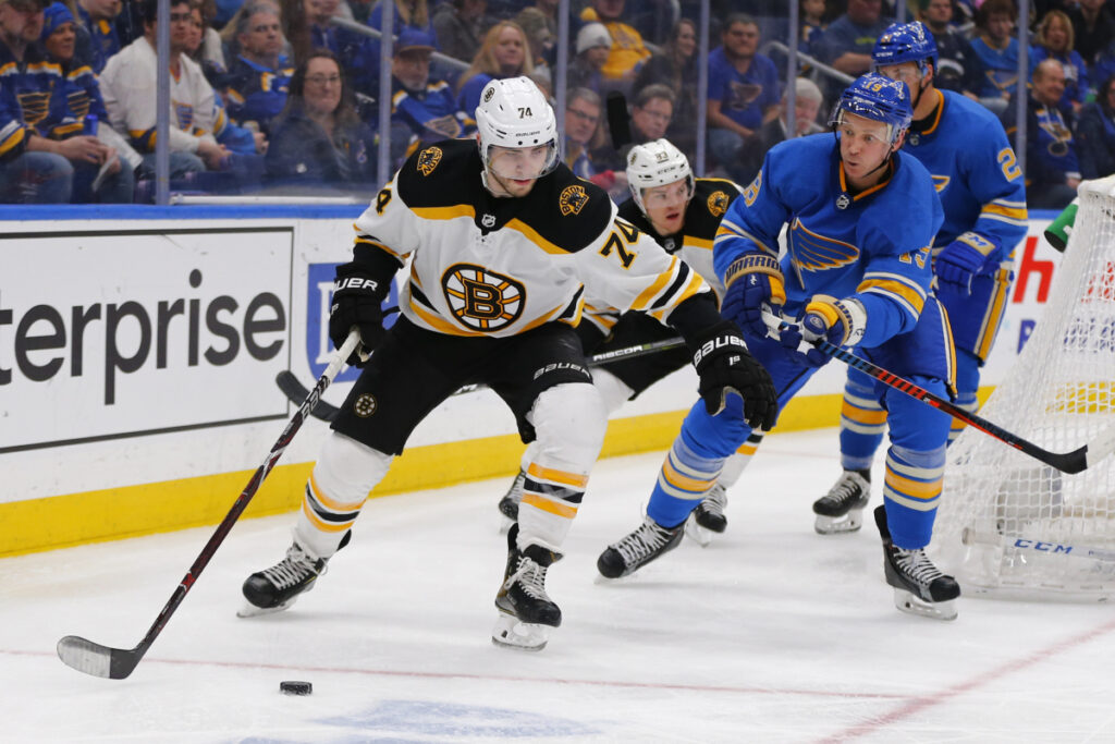 Boston's Jake DeBrusk controls the puck against St. Louis' Jay Bouwmeester during the third period of the Bruins' 2-1 shootout loss on Saturday in St. Louis.
